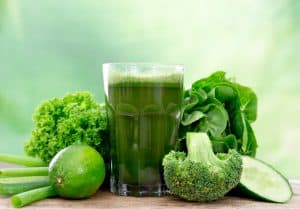 glass of green juice plus vegetables made by juicing in your home