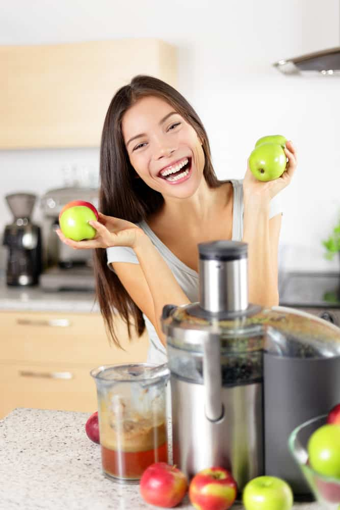 woman with juicer machine juicing for better health
