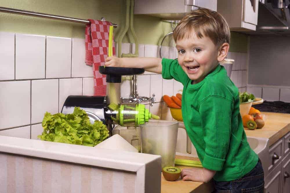 juicing for kids - kid making green juice